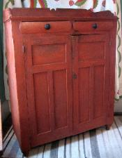 Painted red jelly storage cupboard